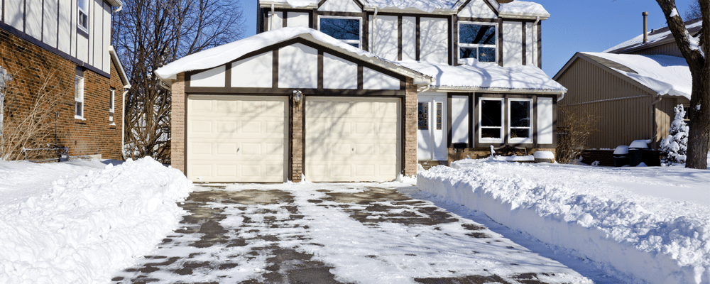 winterizing your home with a garage and snow on the frontyard
