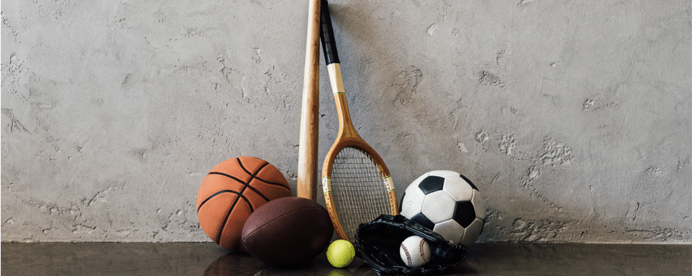 various sports equipment with a wall background