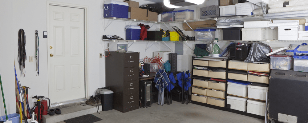 different objects inside a garage that is used as a storage space