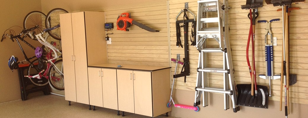 Organized Garage by Garage Designs using StoreWALL